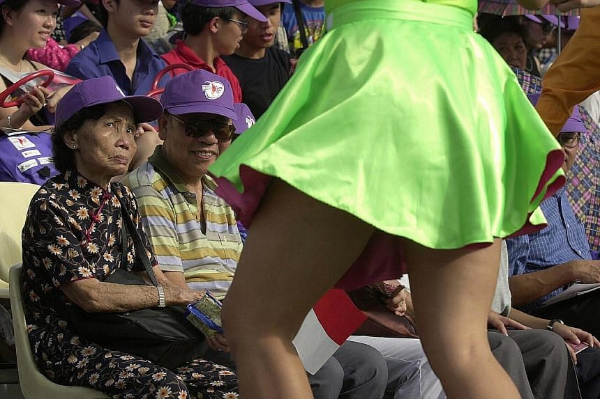 An elderly couple watching Lindy Hop dancers at the Padang during the NDP preview show in 2000.