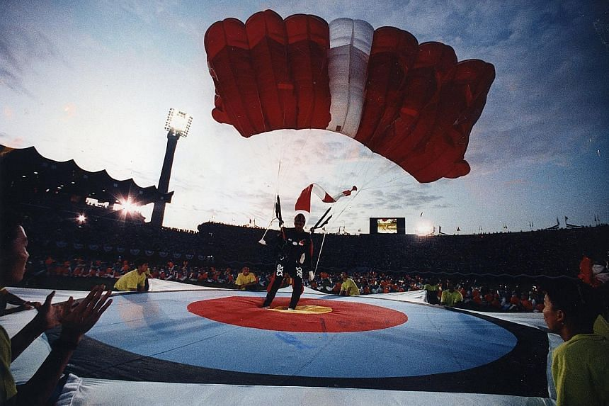 Free-fallers landing with precision on a 3m-wide target to the delight of the crowd at the National Stadium during the 1992 parade.