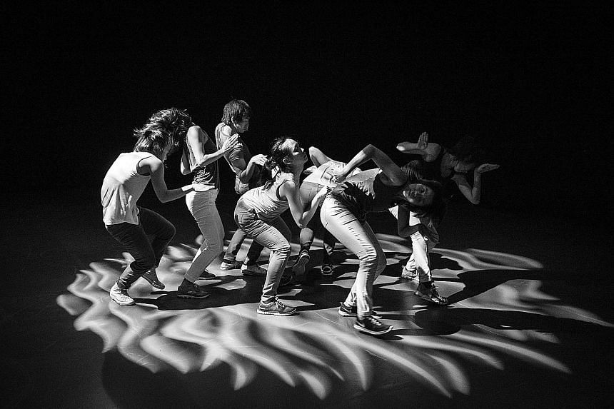 Tan Ngiap Heng's black- and-white photos include those taken at the dance work, Free (2014, above), by Raw Moves; and theatre production, The Weight Of Silk On Skin (2011, featuring actor Ivan Heng), by Wild Rice.