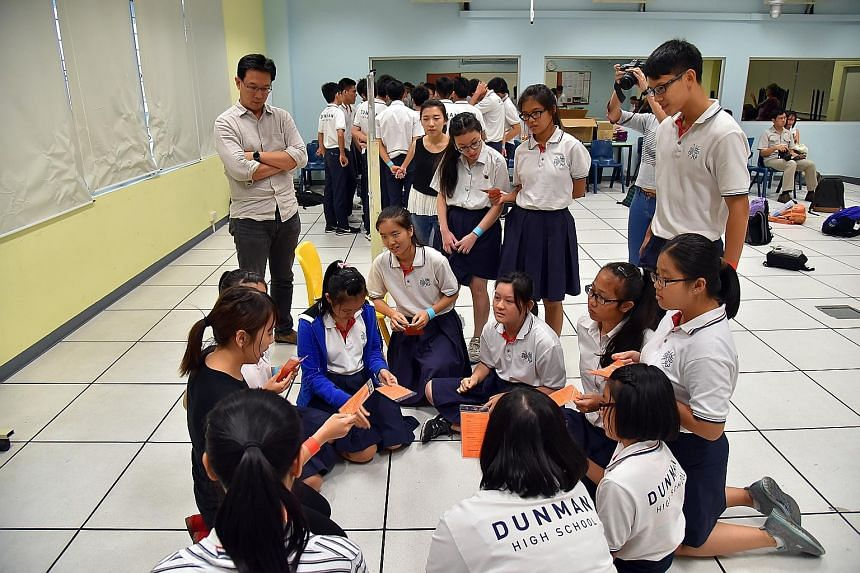 Gateway Entertainment's Mr Wan (far left), who suggested at an SGfuture dialogue that a role-playing game be created to educate students on what to do during a crisis, tried out some game scenarios with Dunman High students last month.