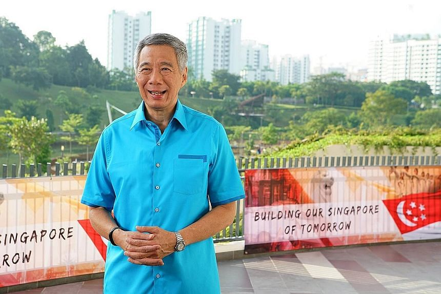 """Unity """"is more than a warm, fuzzy feeling"""", says PM Lee, delivering his National Day message from Safra's new Punggol clubhouse. """"It's the iron resolve to hold together, despite the challenges, despite the sacrifices we have to make."""""""