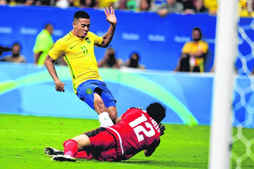 Brazil's Jesus Gabriel is thwarted by Iraq goalkeeper Mohammed Hameed during their 0-0 draw. The hosts must beat Denmark tomorrow or risk a humiliating knockout in the group stage.