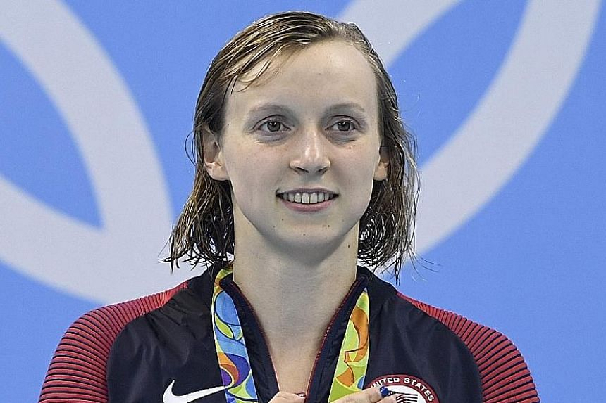 Clockwise, from left: Sweden's Sarah Sjostrom, as seen by an underwater camera, during her 100m butterfly win in a world-record time of 55.48sec. Katie Ledecky of the United States on the podium after winning the 400m freestyle in 3min 56.46sec, taki