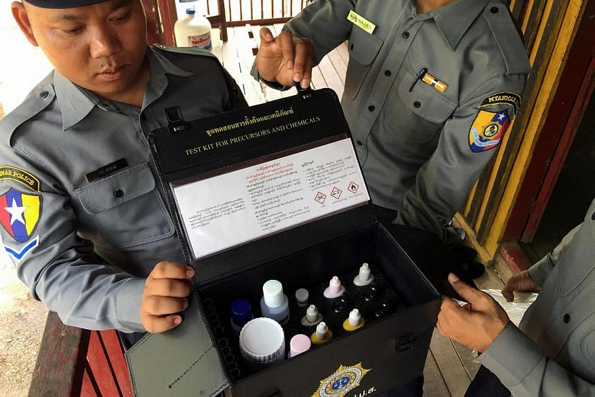 Police in Myanmar's Tamu district show a test kit used to identify pseudoephedrine in Myanmar's Chin State, near the border with India, on May 11.