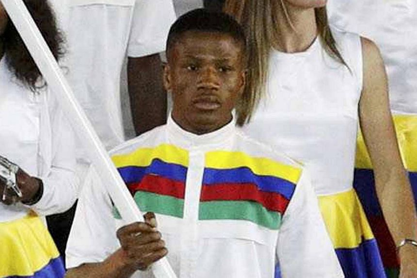 Flagbearer Jonas Junius of Namibia leads his contingent during the opening ceremony.