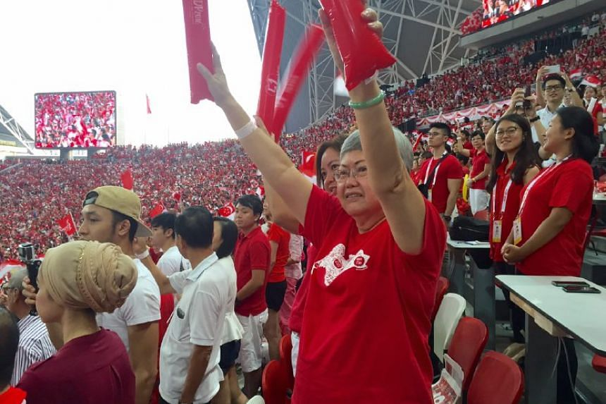 Spectators cheering as PM Lee Hsien Loong enters the stadium, on Aug 9, 2016.