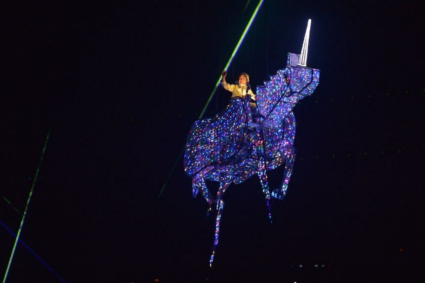 A boy riding a unicorn flying over the audience, at the National Stadium on Aug 9, 2016.
