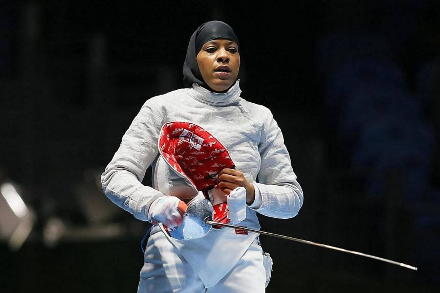 Ibtihaj Muhammad of the USA reacts after losing to Cecilia Berder of France in the women's Sabre individual round of 16, of the Rio 2016 Olympic Games Fencing event, on August 8.