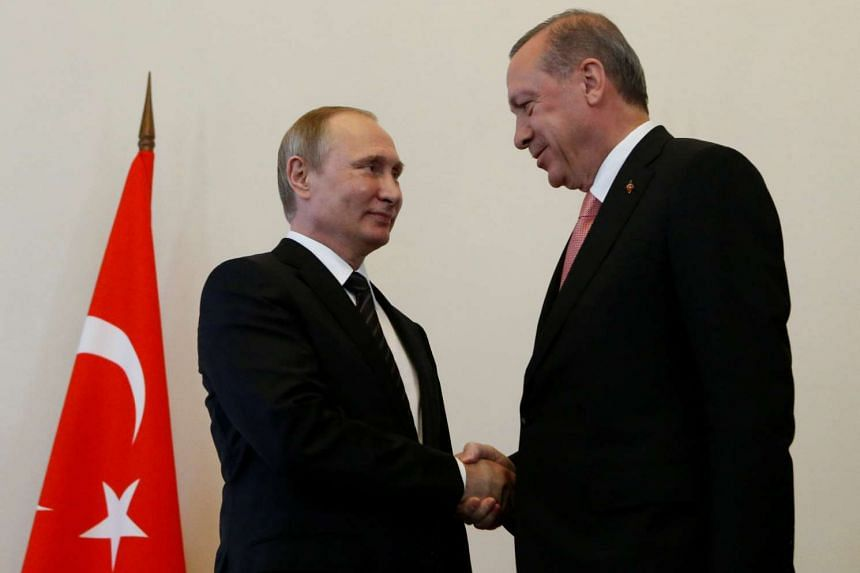 Russian President Vladimir Putin shakes hands with Turkish President Tayyip Erdogan during their meeting in St Petersburg, on Aug 9, 2016.
