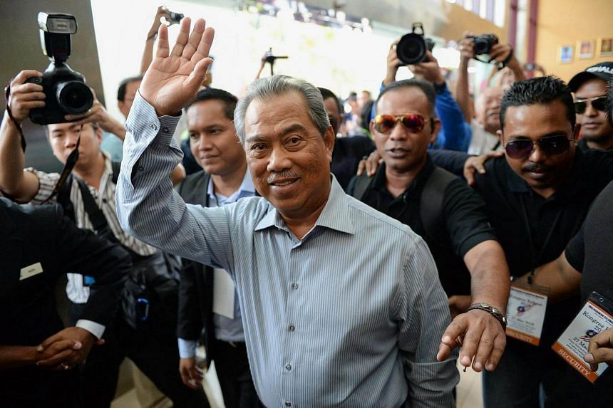 Malaysia's former DPM Muhyiddin Yassin waves as he arrives during a rally in Shah Alam, outside Kuala Lumpur on March 27.