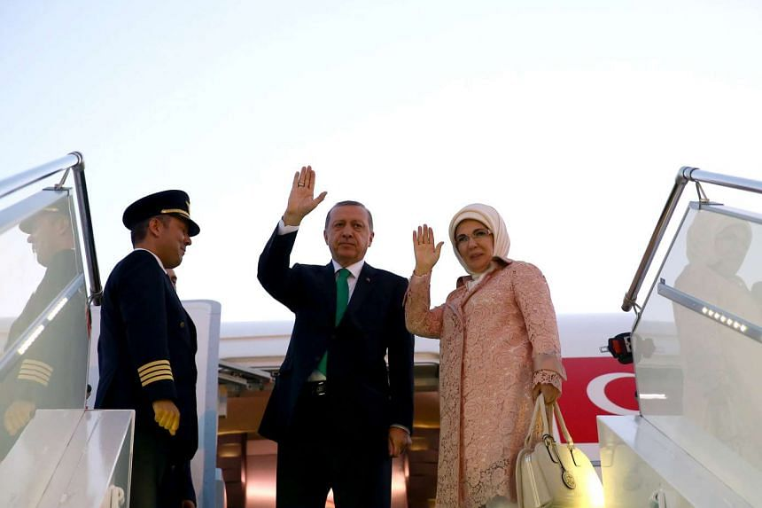 Turkish President Tayyip Erdogan, seen here with his wife  Emine Erdogan, says he wants to start on a clean slate with Russia, after Turkey downed a Russian fighter jet near the Syrian border last November.