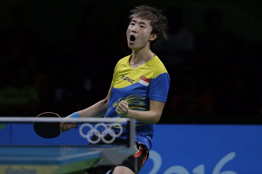 Feng Tianwei of Singapore in action against Liu Jia (unseen) of Austria during the Rio 2016 Olympic Games table tennis women's singles fourth round match in Rio de Janeiro, Brazil, on August 8.