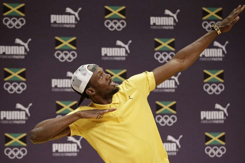 Sprinter Usain Bolt flashing his signature pose during a press conference held by the Jamaican Olympic Association at Cidade Das Artes in Rio de Janeiro.