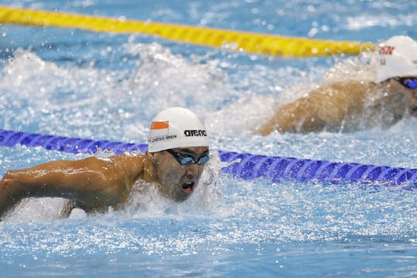 Quah Zheng Wen heads for the finish line in the  men's 200m butterfly heats at the Olympic Aquatics Stadium, placing third to qualifyfor the semis.