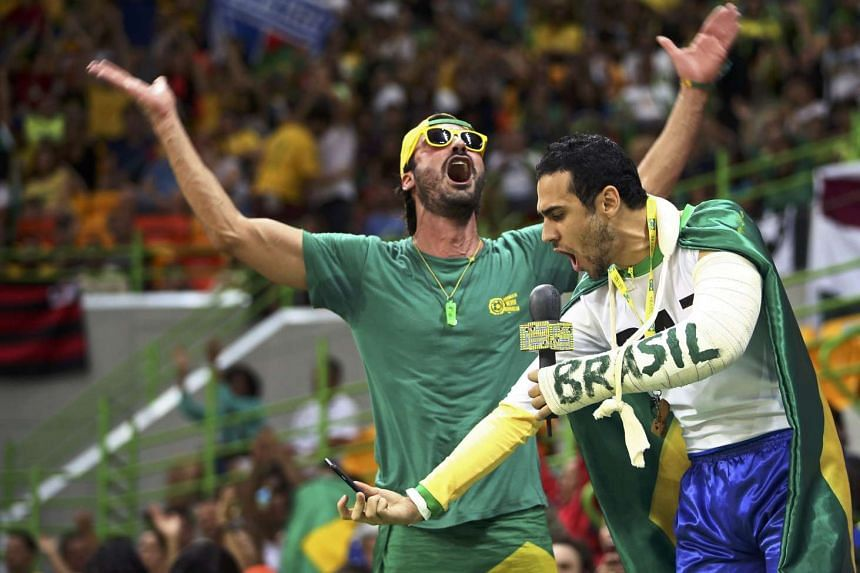 Brazilians fans react during a handball match at the Olympics in Rio.