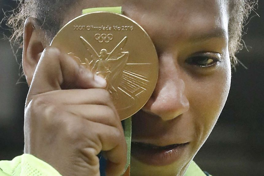 Brazil's Rafaela Silva celebrates with her gold medal following the women's -57kg judo contest in Rio on Monday.