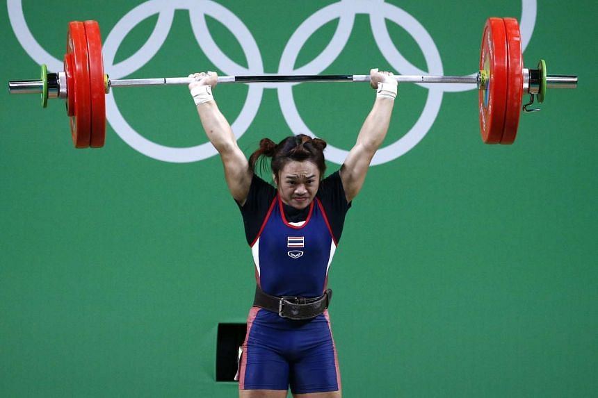 Sukanya Srisurat of Thailand lifts during the women's 58kg group on her way to the gold medal.