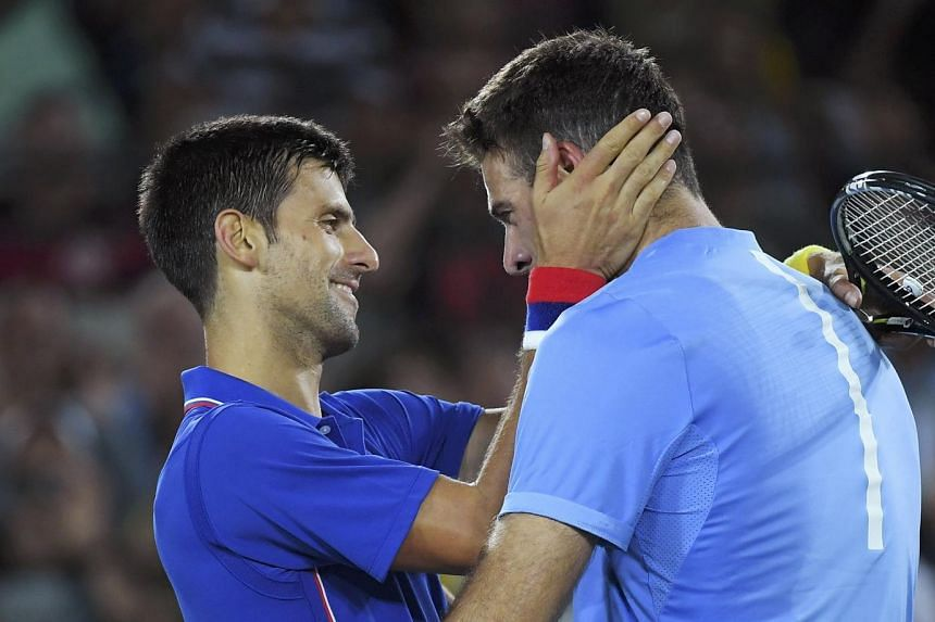 Novak Djokovic (left) of Serbia reacts after losing his match against Juan Martin Del Potro of Argentina.