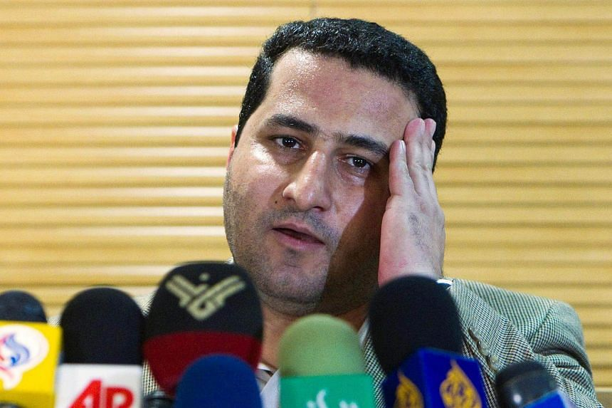 Iranian scientist Shahram Amiri speaks to journalists as he arrives at the Imam Khomini Airport in Tehran, in July 15 2010.
