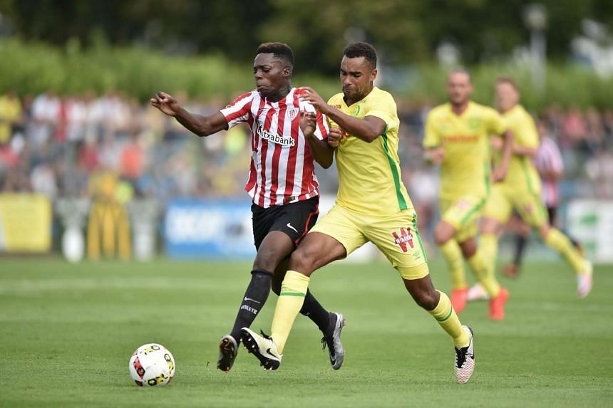 Athletic Bilbao's Spanish forward Inaki Williams (left) vies Nantes' French defender Levy Djidji during the friendly football match between Nantes (FCN) and Athletico Bilbao on July 30.
