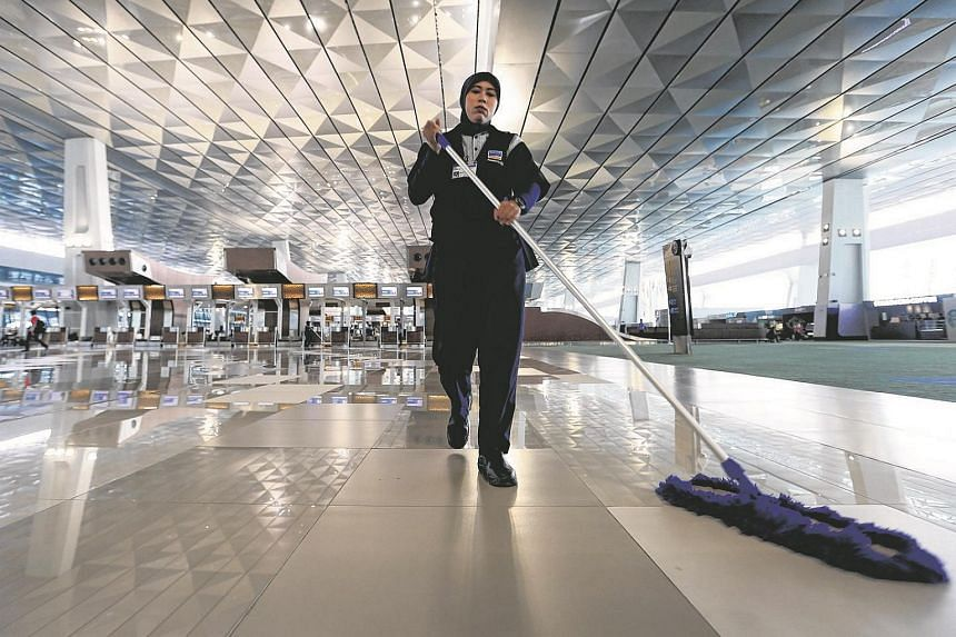 A worker sweeps the floor of the new Terminal 3 Ultimate at Soekarno-Hatta International Airport in Jakarta, Indonesia, August 5.