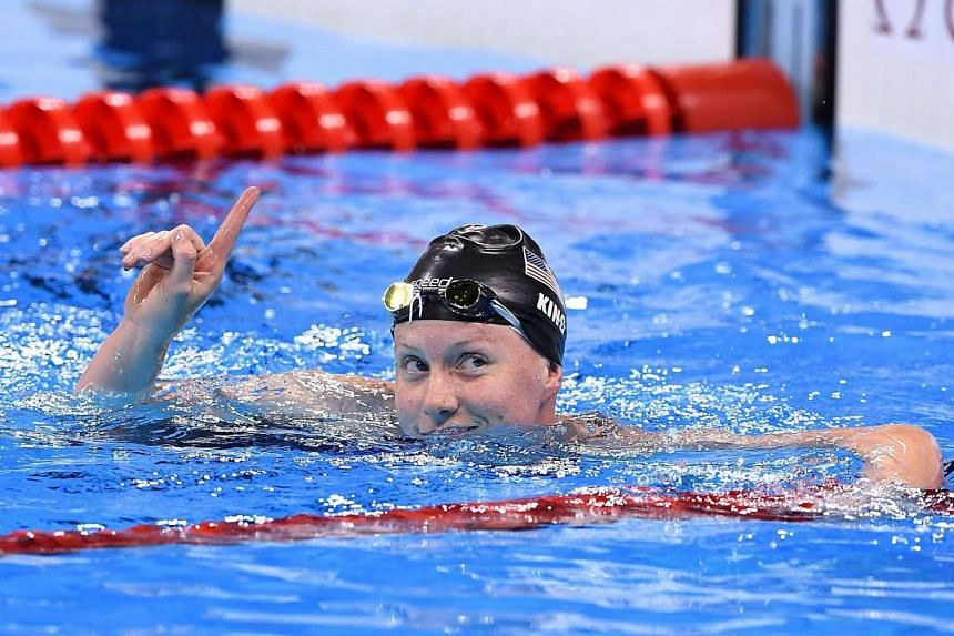 Lilly King of USA reacts after winning the women's 100m Breaststroke semifinal.