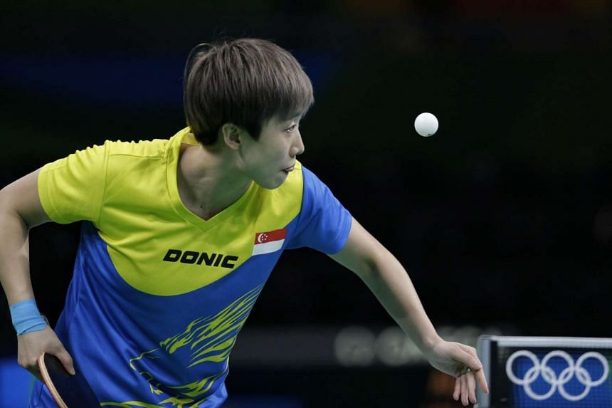 Feng Tianwei of Singapore in action against Liu Jia (unseen) of Austria.