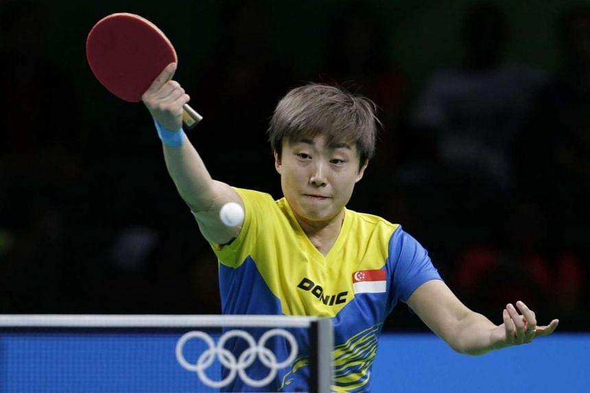 Feng Tianwei of Singapore beats Austrian Liu Jia (unseen) for place in quarter-finals.
