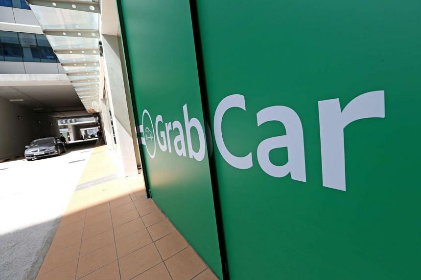 The GrabCar driver was attacked by two men with 10 previous criminal records between them on Aug 9, 2016.