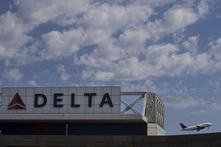 A Delta Air Lines jet takes off at LaGuardia Airport in New York on August 8.