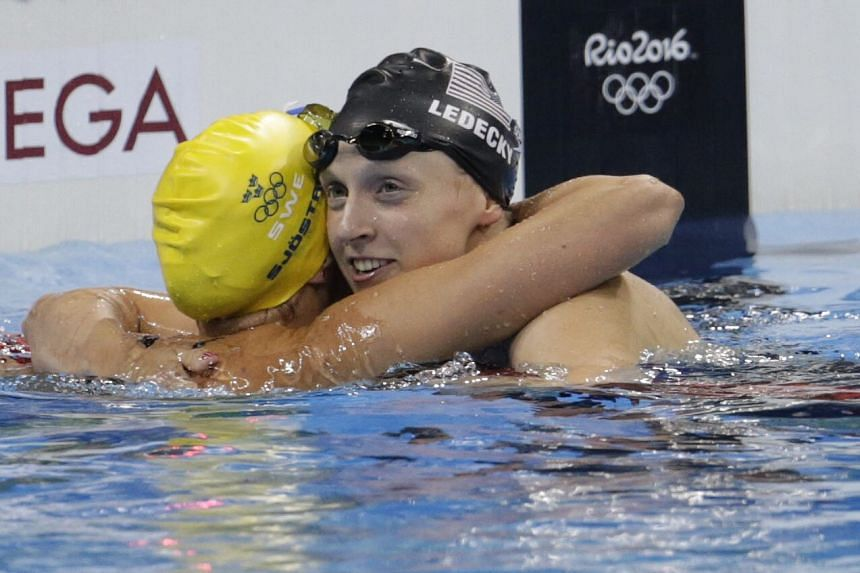 Katie Ledecky (right) of the USA is congratulated by Sarah Sjostrom of Sweden after winning the women's 200m Freestyle final of the Rio 2016 Olympic Games Swimming events at Olympic Aquatics Stadium at the Olympic Park in Rio de Janeiro, Brazil on Au