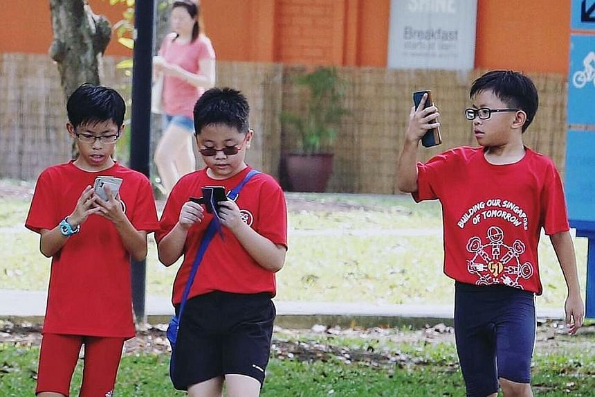 A group of boys on a Pokemon Go quest at East Coast Park. Activities were held at various venues in conjunction with the game. Gaming firm Razer sponsored Singapore's first PokeCrawl along Orchard Road yesterday, which began at Ion Orchard and ended