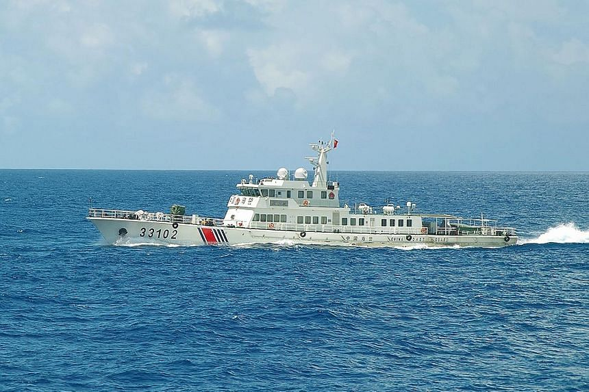 "A Chinese coast guard ship sailing near disputed East China Sea islands on Sunday. Since Friday, Japanese officials have repeatedly protested against what Tokyo calls ""intrusions"" by Chinese ships in the territorial and contiguous waters of the islan"