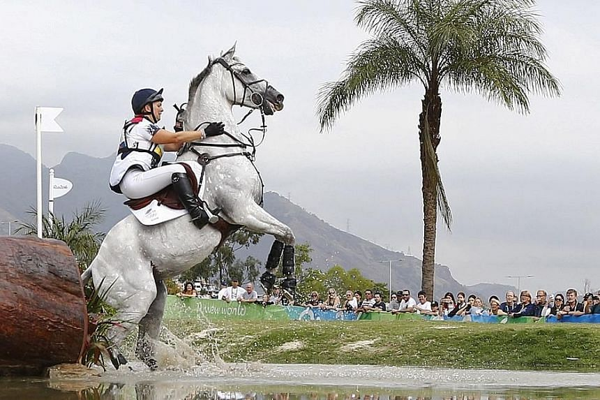 Gemma Tattersall of Britain attempting to cross one of the water obstacles during the preliminary individual eventing cross country at the Deodoro Olympic Equestrian Centre on Monday.