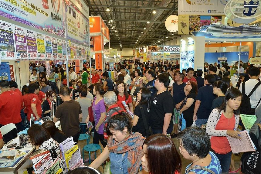 The crowd at the Natas Travel Fair last year. This year's Natas fair is on from Friday to Sunday. The Travel Revolution fair will be on from Aug 19 to 21. Admission to both fairs is free.