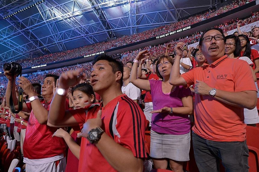 Fireworks light up the Kallang skyline, rounding off a night of celebration. Many parade-goers left the National Stadium early to catch a glimpse of the outdoor pyrotechnics, which were set off from the stadium's domed roof as well as from three barg