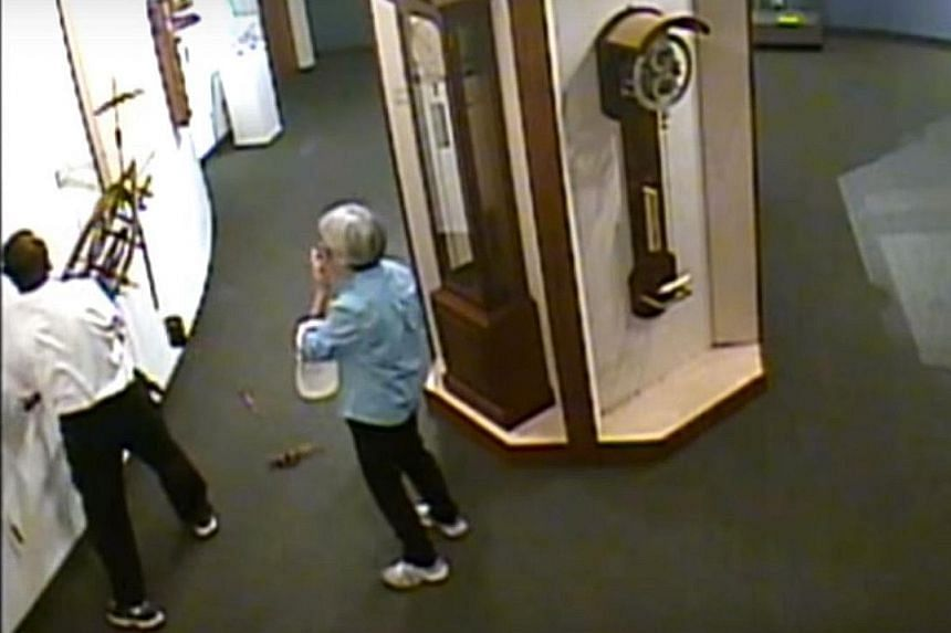 A visitor at the National Watch and Clock Museum in Columbia, Pennsylvania, caught hold of the clock he was fiddling with when it fell and tried to attach it back to the wall.