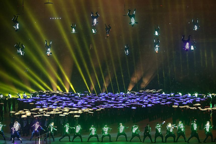 Like a scene from a science fiction movie, 20 aerialists from the SAF Music and Drama Company spin in midair while 720 performers from Commonwealth Secondary School, Kranji Secondary School and the Academy of Nutz dance to the tune of the future, cla