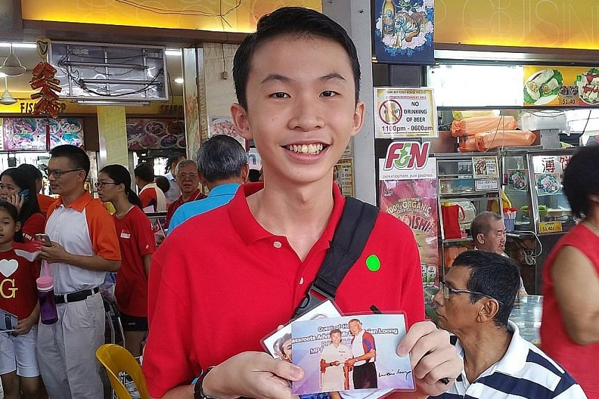 Mayflower Secondary School student Goh An Soon made the most of yesterday's community walk by getting PM Lee to sign a photograph he had taken with him two years ago.
