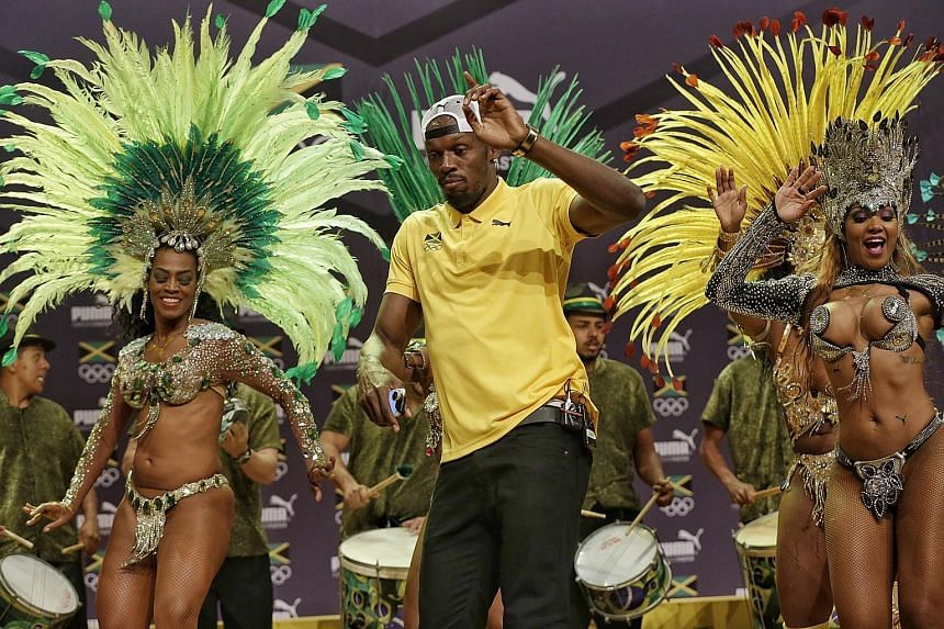 Jamaican sprinter Usain Bolt showing he can put on a show off the running track as well as he can on it, sashaying with samba dancers at the City of Arts in Brazil.