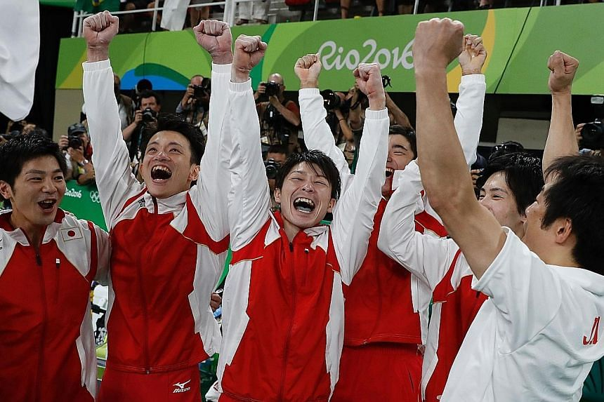 Top: Japan's Kohei Uchimura performing on the rings, setting his country on their way to gold in the artistic gymnastics team final at the Rio Olympic Arena. Left: The victorious Japanese team celebrating clinching their gold medal, and in doing so,