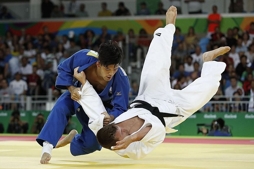 Japan's Shohei Ono (blue) competing with Belgium's Dirk van Tichelt in their men's -73kg semi-final. The Japanese said his victory in the final should inspire smaller judoka to achieve greater feats.