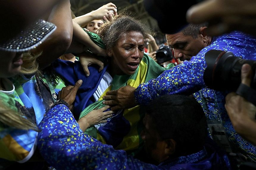 Rafaela Silva, born and bred in Rio, weeping tears of joy as she celebrates her gold medal marking her rags-to-riches rise from favela to Olympic judo gold medallist.