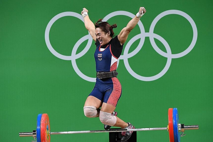 Thailand's Sukanya Srisurat celebrating her triumph in the women's 58kg class on Monday. She had served a two-year drug ban from 2011 to 2013 after testing positive as a 16-year-old for the anabolic steroid methandienone.