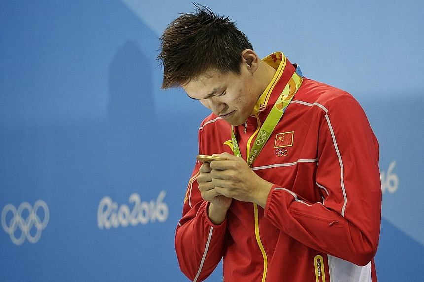Sun Yang with his 200m freestyle gold medal. Fellow Olympians Michael Phelps and Lilly King had criticised the Chinese star, previously banned for doping, and fellow cheats.