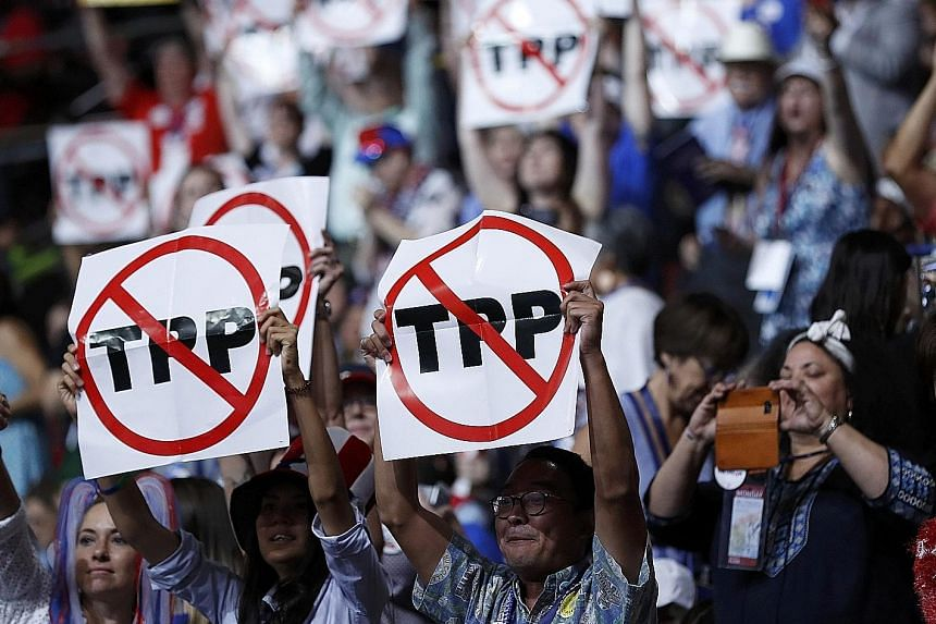 Delegates protesting against the Trans-Pacific Partnership at the first session of the Democratic National Convention in Philadelphia last month.