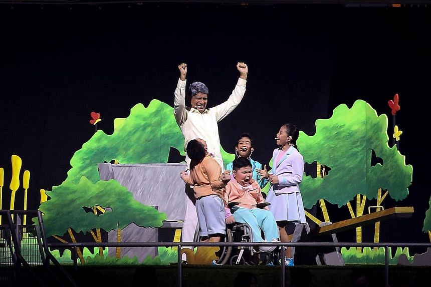 Anchoring the skit are actors (from left) R. Chandran, 60, Shadrach Yankaya (back facing), nine, Bryan Cheong (on wheelchair), 10, Jivan Wei Ramachandran, eight, and Nyla Esman, 11. Their skit called on Singaporeans to ponder about their hopes and dr