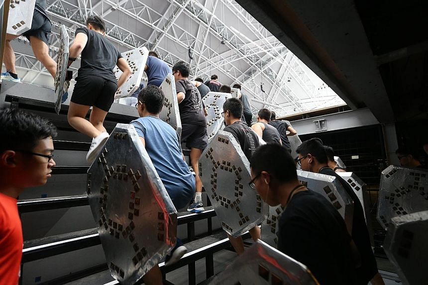 "Performers of the Badang segment go through their paces during a rehearsal. The space under the 2.5m-high stage could hold about 300 people, and there were 34 ventilation fans under the stage that kept the technicians and waiting performers cool. ""Sh"