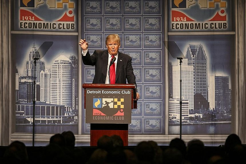 Mr Trump presenting his economic plans to the Detroit Economic Club on Monday. Although he chose the city in a clear appeal to the working-class at the centre of his political strategy, the economic policies he is planning to implement as president w