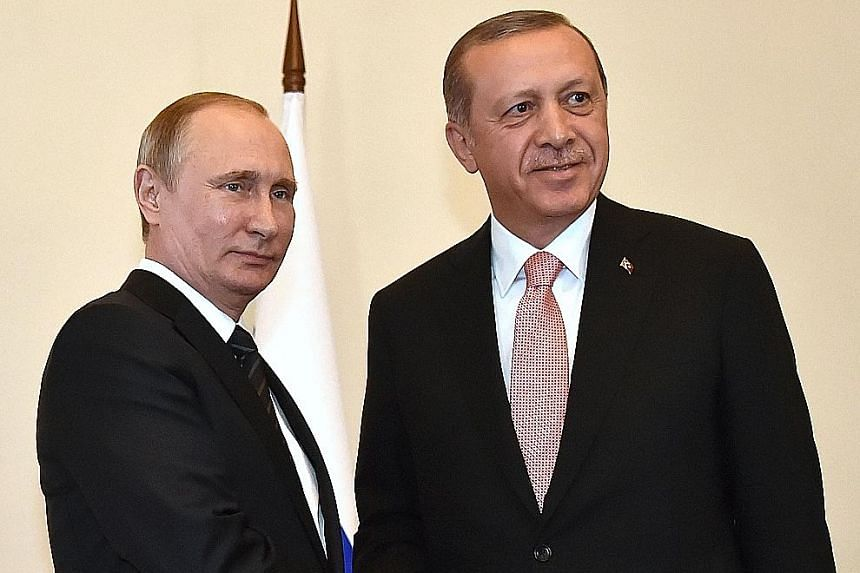 Mr Putin (left) welcoming Mr Erdogan to Saint Petersburg in their first encounter since Turkey downed one of Russia's warplanes last November, sparking a deep diplomatic crisis.
